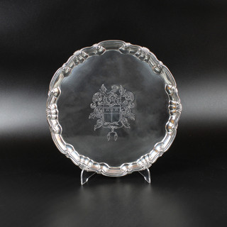 William Peaston 1747 -  Salver with shell and scroll boarder on three bracket feet   Scratch weight on base.  Engraved with arms- helm and crest and extravagant scroll mantling.  More or less contemporary initials K. M. H.  16 oz 17dwt 9 ½ inch  £1,800.00