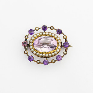 15ct yellow gold mounted Victorian amethyst and seed pearl triple circlet brooch.  £575.00