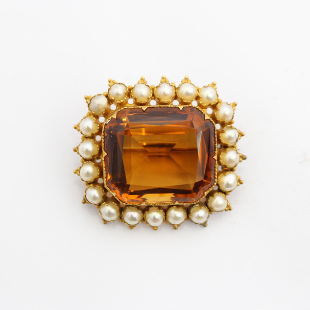 A Victorian 15ct yellow gold citrine and pearl brooch. The citrine of deep rich colour. Fine condition. £750.00