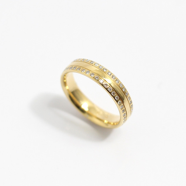 A 18ct yellow gold 'Court' profile wedding band set with full diamond edges. The width of the band 4 1/2mm. Finger size M. £950.00