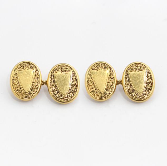 18ct yellow gold oval chain cufflinks with shield motif. £750.00