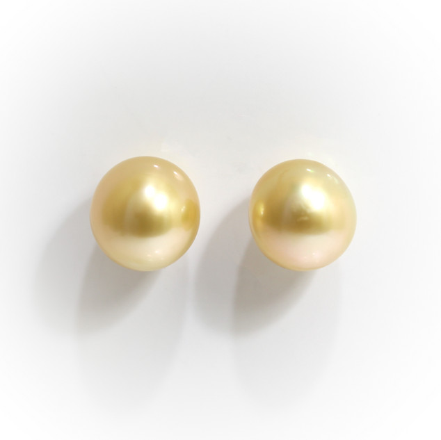 South Sea natural coloured golden pearl stud earrings measuring 11mm with 18ct white gold post and butteries. £650.00