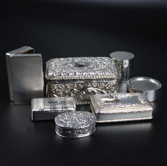 We have a range of silver boxes, some of which are photgraphed here.  1. Paget & Braham 1937. Engine turned snuff box 3 inches. 3 oz. £ 450.00 2. Chester 1898. Jewel casket with purple velvet interior, chasted lid and sides. £250.00 3. Edward Smith. Gilded snuff box with applied floral border to lid. Engraving has been removed. 4 oz 18 dwt. (Engine turned panels somewhat worn ) £485.00  4. Plain circular box with push on lid. Grey-Harris & Co. 1998 £185.00 5. Circular boxes, London 1998. 2 ¼ oz £150.00 each. 6. Silver and gilt snuff box. S Pemberton, Birmingham 1816. £600.00 7. Oval, Continental pill box. Stamped 830. £85.00