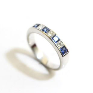 A platinum sapphire and diamond half eternity ring. Total sapphire weight 0.30ct, diamond weight 0.51ct, G colour, Vs1 clarity. £2,000.00