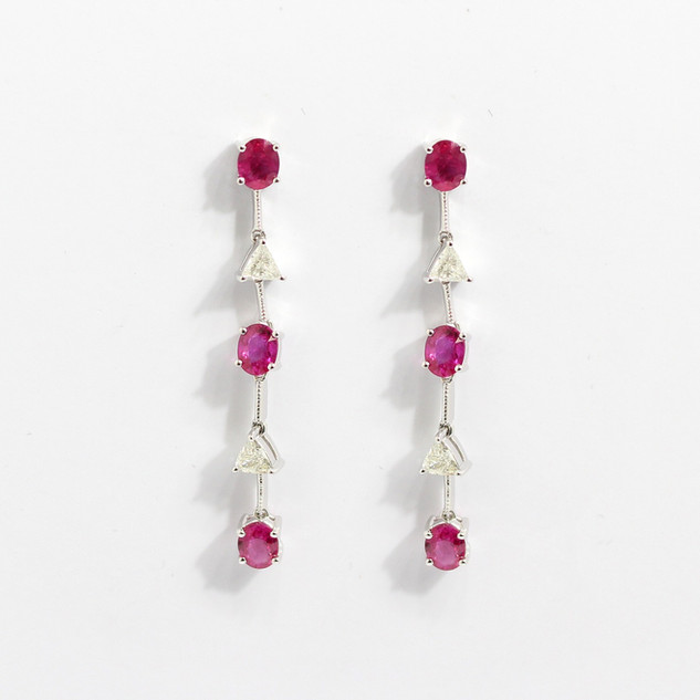 18ct white gold, pink sapphire and diamond drop earrings. The oval cut pink sapphires 1.20cts, with articulated trillion cut diamonds at 0.40ct. £2,250.00