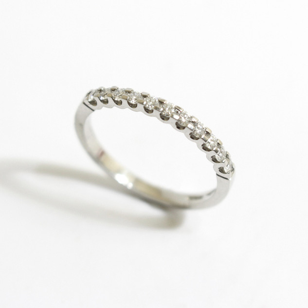 A platinum diamond half eternity ring. The brilliant cut diamonds totalling 0.32ct, G colour, Vs clarity.  £1,200.00