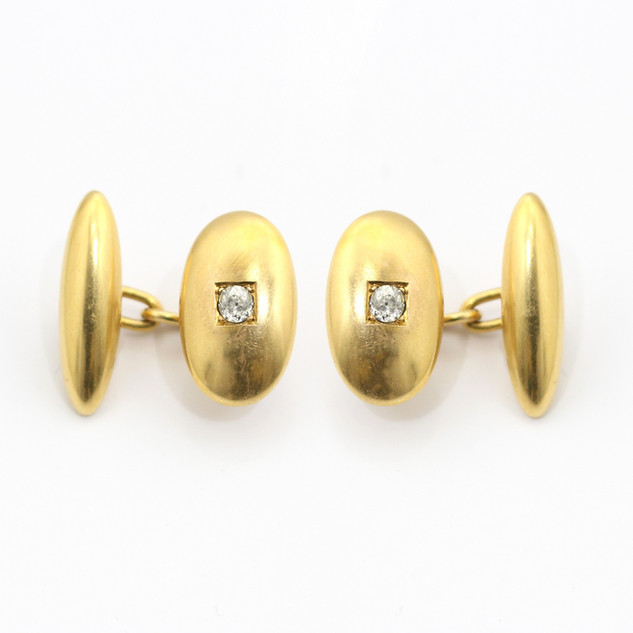 18ct yellow gold domed oval and bullet form cufflinks set with old cut diamonds. £1,750.00