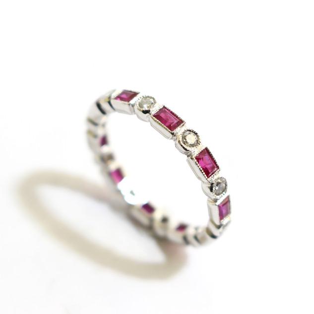 18 ct white gold ruby and diamond full eternity ring. Rubies 1.05 ct diamonds 0.31 ct. G colour, Vs1. Millgrain setting.  £1,300.00