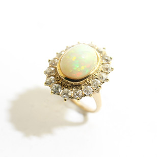 A Continental 14ct yellow gold opal and old cut diamond cluster ring. Total diamond weight 1.70cts. £3,750.00