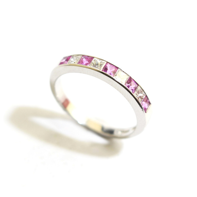 18ct white gold pink sapphire and diamond half eternity ring. Total sapphire weight 0.45ct, total diamond weight 0.33ct. £950.00