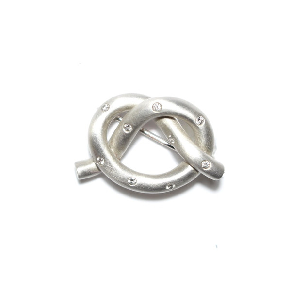 18ct white gold brushed finish 'Knot' brooch set with small modern brilliant cut diamonds. £1,250.00