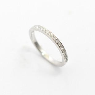 Platinum diamond set half eternity ring. The channel set brilliant cut diamonds totalling 0.21ct. £1,350.00