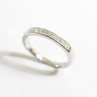 A platinum diamond set half eternity ring. Total weight of princess cut diamonds 0.40ct. £850.00