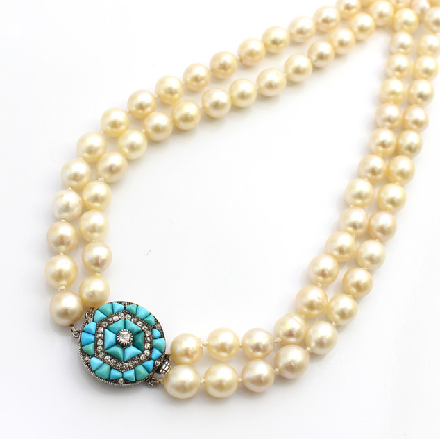 A double row of cream cultured pearls, 8mm with a turquoise and diamond snap. £1,850.00