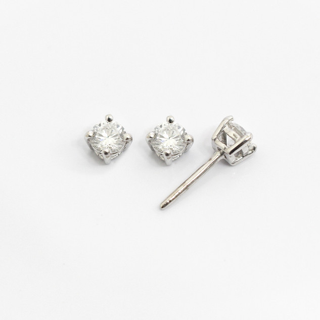 18ct white gold diamond stud earrings. The modern brilliant cut diamonds 0.30ct each, G colour, Vs2/Si1 clarity. £2,500.00