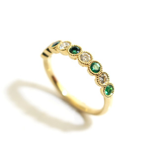18ct yellow gold emerald and diamond scallop millgrain set half eternity ring. Total emerald weight 0.35ct, diamond weight 0.30ct, G colour, Vs1 clarity. £1,850.00