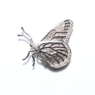 18ct white gold diamond set butterfly brooch. £1,100.00