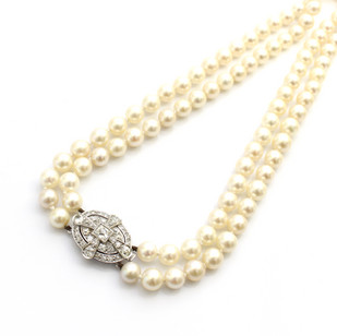 A double row of cultured pearls of fine lusture, 7.5mm. Completed with a 1930's diamond clasp weighing 4.50cts. £6,500.00