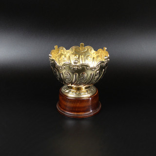 Silver guilt rose bowl 5 ¾ inches diameter  The scroll border with Angelic masks. £575.00  (Plinth included)