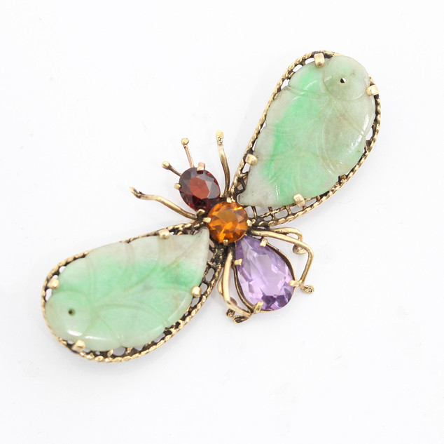 14ct gold flying insect brooch. Made in the USA during the 1960's the brooch comprises of carved jade wings and a garnet, citrene and amethyst thorax. £785.00