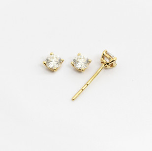 18ct yellow gold diamond stud earrings. The modern brilliant cut diamonds 0.25ct each, G colour, Si clarity. £1,850.00