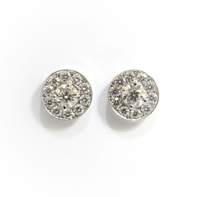 18ct white gold diamond stud earrings. The total weight of brilliant cut diamonds 1.30cts. £5,750.00