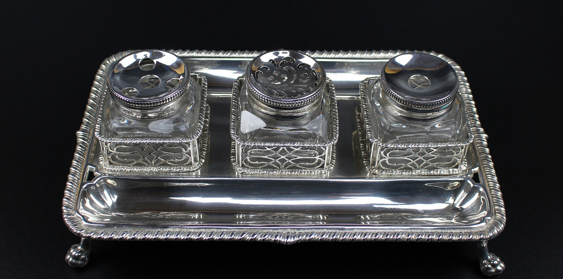 Ink stand William Robertson Rectangular Gadroon boarder with pierced bottle holders. 10 ¼ inches by 6 ½ inches Lion claw feet Date - 1759 24 oz silver £4,500.00