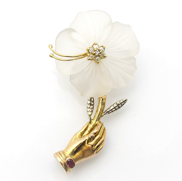 14ct yellow gold flower brooch. Comprising of a single carved white charlcedony flower head with diamond centre. The stem completed with engraved decoration and gem set hand. Italian, circa 1970. £2,750.00