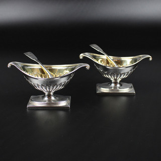 William Fountain and Daniel Pontifex 1791.  Pair of salts in elegant oval vase form, half fluted with square base.  Gilt inside.  Engraved with Burning Brazier Crest   1791 * redo ticket Spoons with different crest  6oz 15 dwt £650.00