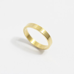 A 18ct yellow gold 'Flat' profile wedding ring. Most wedding rings are priced by weight. This example is 3mm width and is a size O 1/2. £425.00 Please enquire for alternative price and sizing.