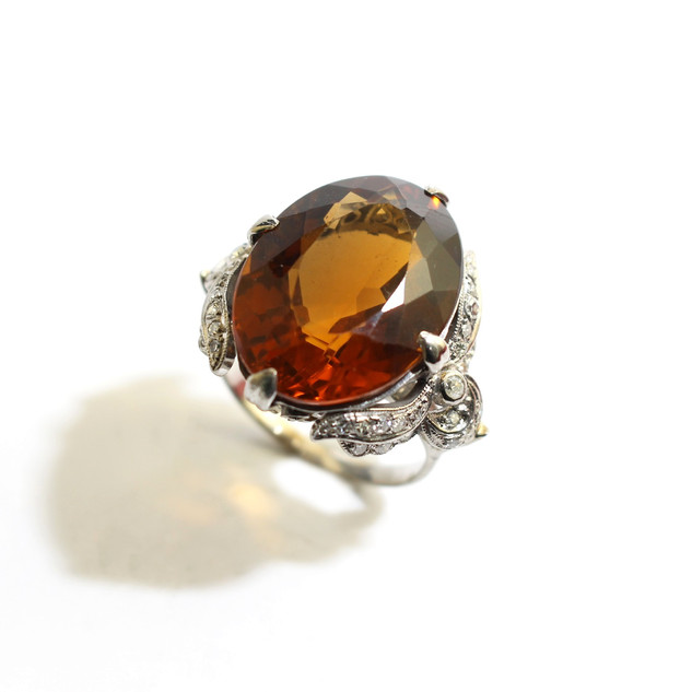 A large 14ct white gold orange quartz and diamond dress ring. £800.00