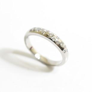 A platinum diamond set half eternity ring. Total weight of brilliant cut diamonds 0.22ct. £1,600.00