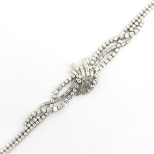 A 1950's 18ct white gold and diamond bracelet. Comprising of brilliant cut and baguette cut diamonds. Estimated total weight of 13.50cts. £14,000.00