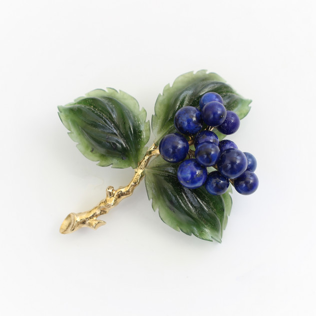 14ct yellow gold floral brooch. Comprising of lapis floral blooms and carved jade leaves. Italian, circa 1960s. £1,450.00