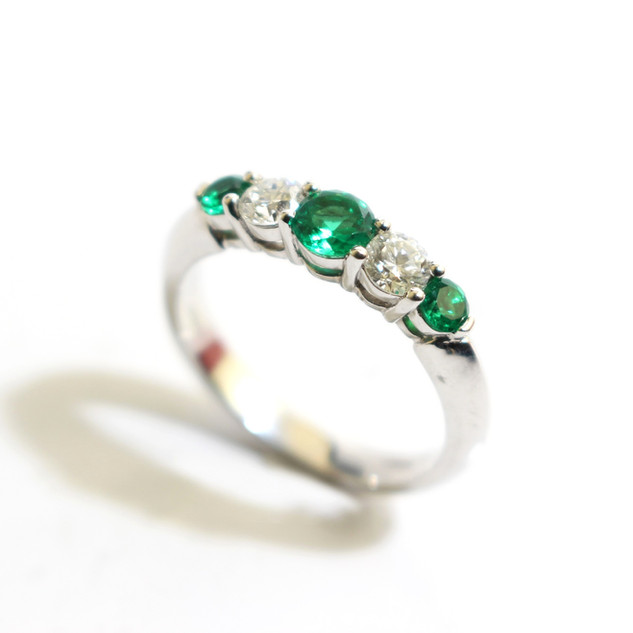 A platinum Columbian emerald and diamond graduated five stone ring. Total emerald weight 0.77ct, diamond weight 0.44ct, G colour, Vs1 clarity. £4,000.00