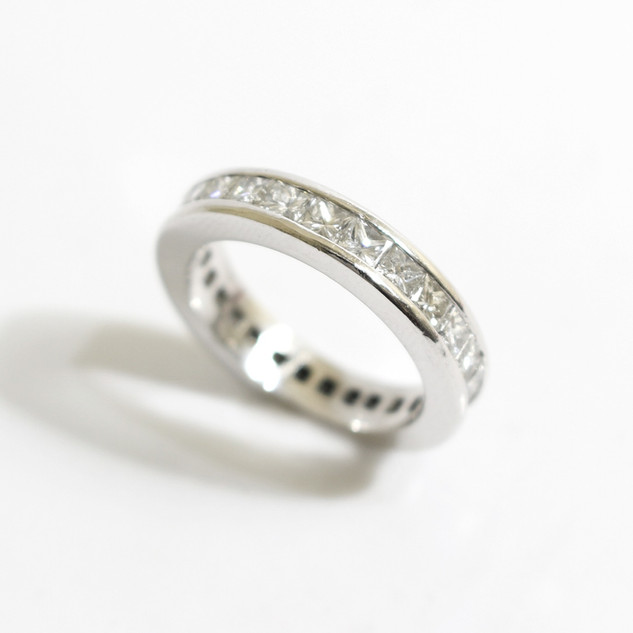 A platinum diamond full eternity ring. The princess cut diamonds totalling 2cts, G colour, Vs1 clarity. £2,850.00