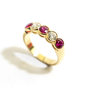18ct yellow gold ruby and diamond scallop set half eternity ring. Total ruby weight 1ct, diamond weight 0.54ct, G colour, Vs1 clarity. £5,500.00