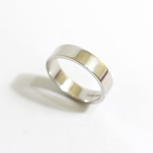 A platinum 'Flat' profile heavy weight wedding ring. Grey-Harris & Co hallmark. Most wedding rings are priced by weight. This example is 5mm width and is a size Q . £980.00 Please enquire for alternative price and sizing.