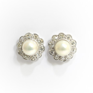 18ct white gold cultured pearl and diamond cluster earrings. The pearls 7.5mm with brilliant cut diamonds totalling 1.10cts. £2,850.00