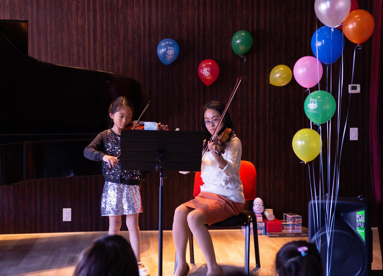 Ms. Xu and violin student
