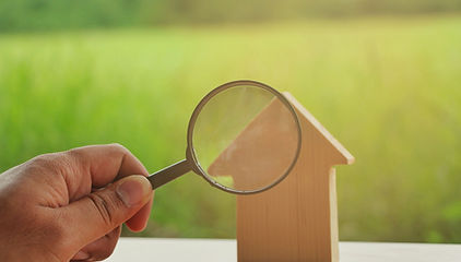 Magnifying glass with mini wood house mo