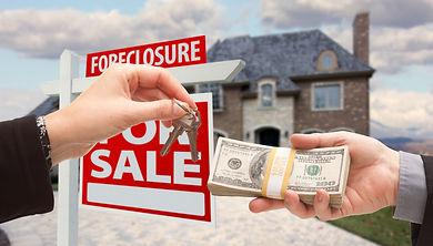 Handing Over Cash For House Keys in Fron