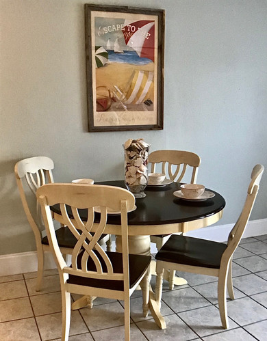 Charming dining table seats four