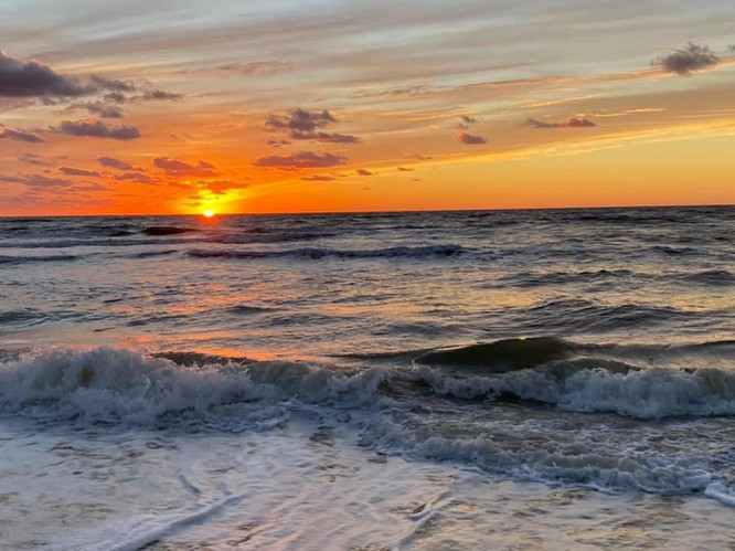 Sunset into the waves