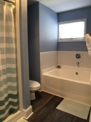 Master bath with shower and soaking tub