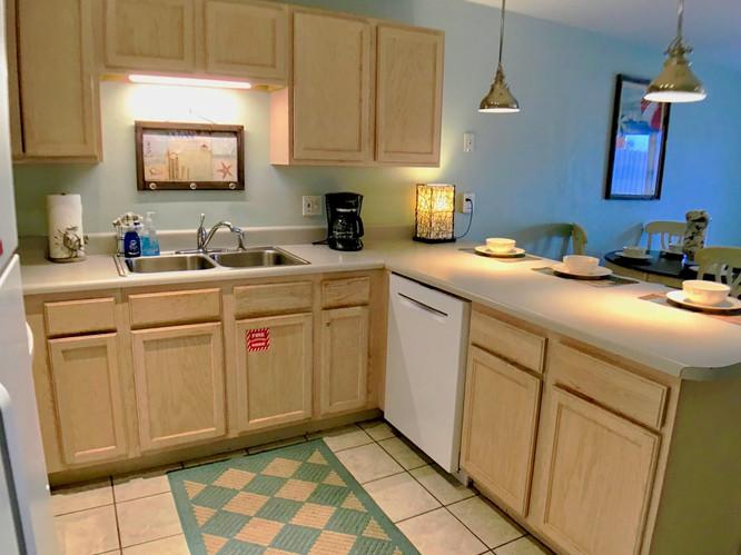 Well stocked kitchen w_new dishwasher