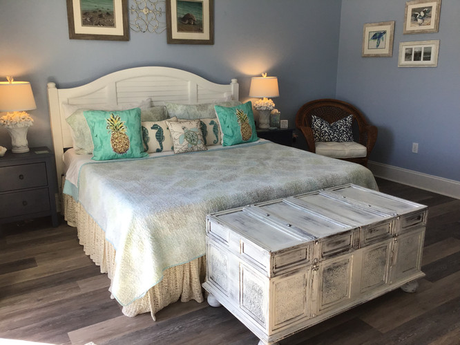 Comfortable king bed in master