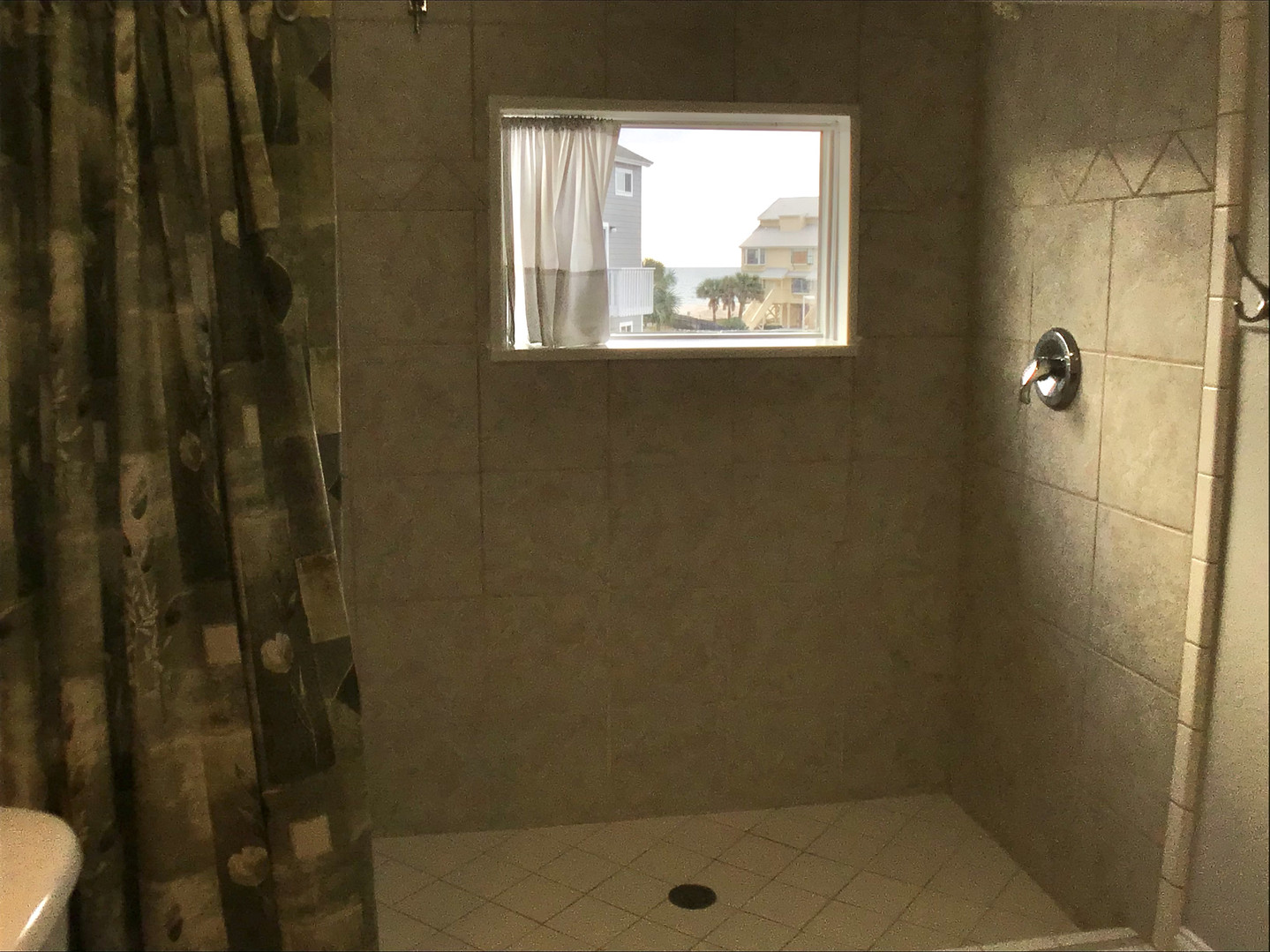 Large walk-in tiled shower with view