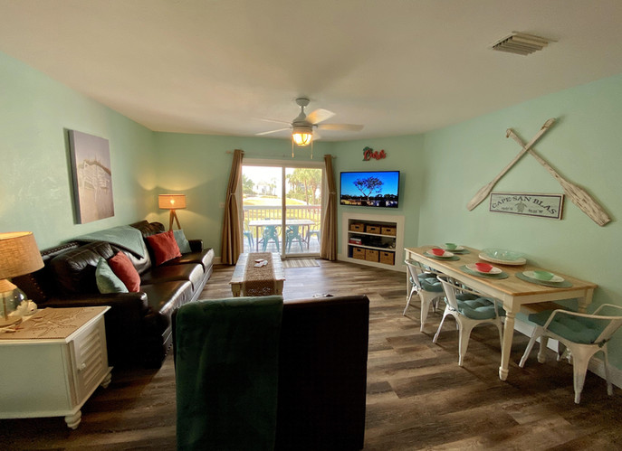 Living-dining area opens to main deck