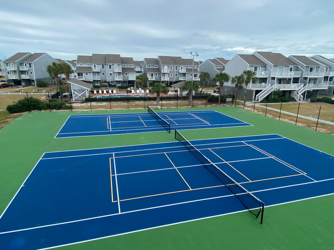 Porches overlook newly resurfaced courts